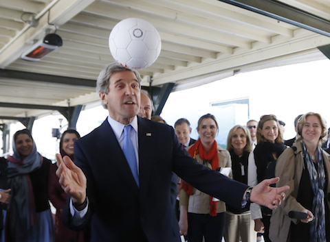 U.S. Secretary of State Kerry heads a soccer ball made in Afghanistan as he meets with Afghan women entrepreneurs at the U.S. Embassy in Kabul