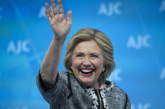 Hillary Clinton waves to a crowd of commoners. (AP)