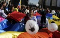 Protestors throw balloons and wave multicolour flags to protest against Chevron
