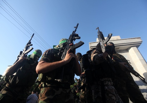 Palestinian militants from various armed factions, including Hamas, attend a news conference in Gaza City