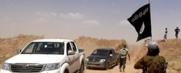 Militants from the al-Qaida-inspired Islamic State of Iraq and the Levant (ISIL) removing part of the soil barrier on the Iraq-Syria borders and moving through it