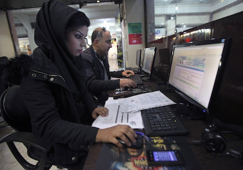 Iranians surf the web in an Internet cafe at a shopping center in central Tehran, Iran