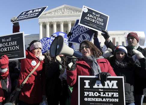 Pro-abortion and anti-abortion protestors rally outside the Supreme Court / AP