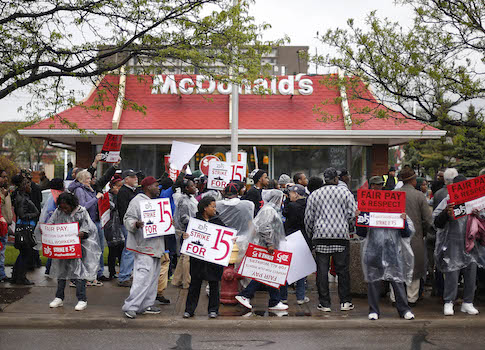 McDonalds protestors picket for higher wages in Detroit / AP