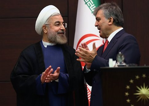 Turkey's President Abdullah Gul, right, and his Iranian counterpart Hassan Rouhani / AP