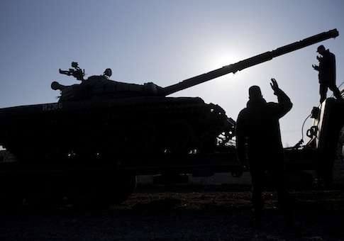 Russian officers gesticulate to the driver of Russian tank T-72B at the Ostryakovo railway station not far from Simferopol, Crimea