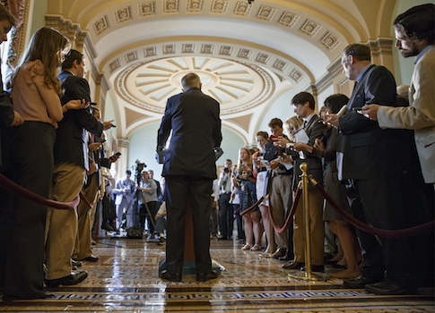 Senate Majority Leader Harry Reid of Nev. speaks to reporters on Capitol Hill / AP