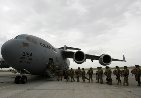 U.S. servicemen from Bravo Company, 234 Battalion 1st Infantry Division, board a plane bound for Afghanistan at the U.S. transit center at Manas airport near Bishkek