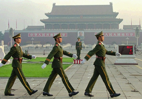 Chinese soldiers march at Tiananmen Square / AP