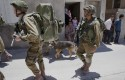 Israeli soldiers search for three missing teenagers outside the West Bank city of Hebron / AP