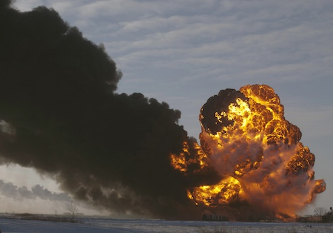 A fireball goes up at the site of an oil train derailment in Casselton, N.D.