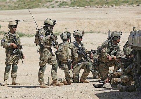Afghan National Army (ANA) soldiers prepare to participate in a military exercise on the outskirts of Kabul