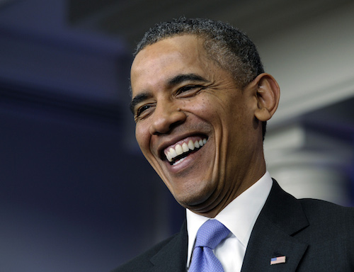 President Obama smiles at the thought of a majestic bald eagle being ruthlessly mauled to death by wind turbines. (AP)