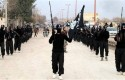 ISIL fighters marching in Syria (AP)