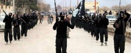 IS fighters marching in Syria / AP