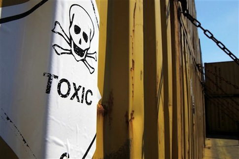 "A sticker reading ""Toxic"" on containers carrying Syria's dangerous chemical weapons, on the Danish cargo ship, Ark Futura, transporting the chemical weapons out of the strife-torn country"