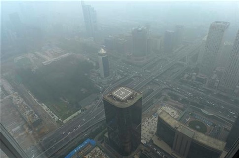 View of high-rise buildings in heavy smog in Beijing, China, July 3
