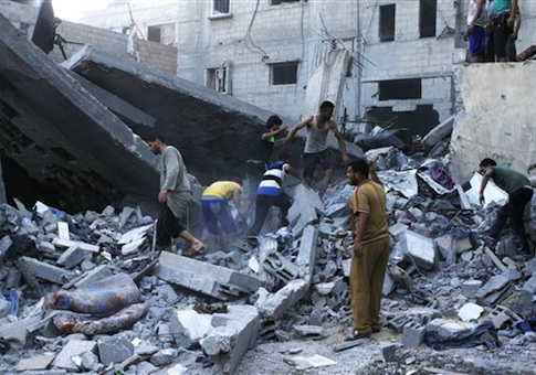 Palestinians remove rubble from the destroyed Ghanam family home in Rafah
