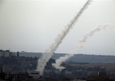 smoke trails are seen after missiles are fired by Palestinian militants from Gaza City towards southern Israel