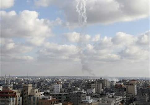 The smoke trail of multiple missiles fired by Palestinian militants from inside northern Gaza Strip