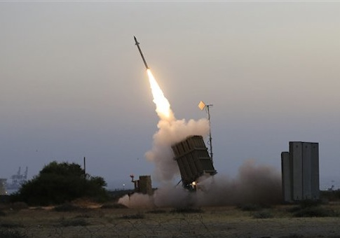 An Iron Dome air defense system in Ashkalon attempts to intercept a rocket fired from Gaza Strip / AP