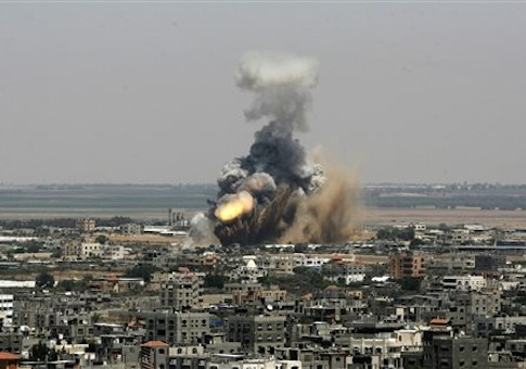 An Israeli missile explodes on impact in Rafah, southern Gaza Strip, on Tuesday, July 8