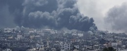 Smoke rises after an Israeli missile hit Shijaiyah neighborhood in Gaza City