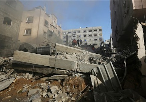 Palestinians inspect the rubble of a house after it was hit by an Israeli missile strike in Gaza City, Thursday, July 10