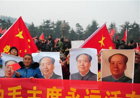 Chinese protestors touting pictures of Mao Zedong / AP