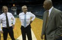 Marc Lasry. center, and Wesley Edens, left, talk to Milwaukee Bucks assistant coach Jim Cleamons / AP