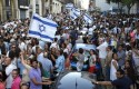 Supporters of Israel wave flags and shout slogans during a demonstration in Marseille