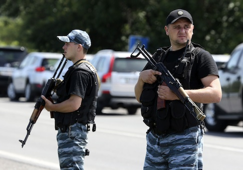 Armed pro-Russian separatists stand guard on the suburbs of Shakhtarsk, Donetsk region