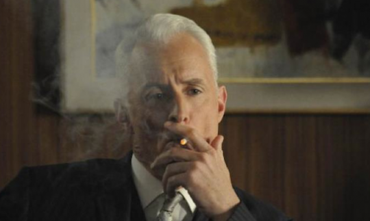 Roger Sterling smoking