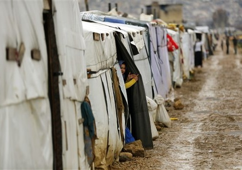 Syrian refugees gather in the Fayda Camp