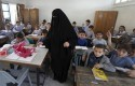 Palestinian children attend a class at the UNRWA elementary school in Shati refugee camp in Gaza City