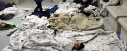 Detainees sleep in a holding cell at a U.S. Customs and Border Protection processing facility / AP