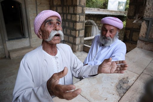 Yazidis praying at Lalish temple (AP)