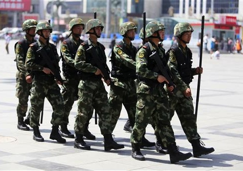 Armed paramilitary policemen patrol the square in front of the Zhengzhou Railway Station in Zhengzhou city, central Chinas Henan province