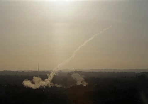 A rocket is fired from Gaza City towards Israel, Saturday, Aug. 9