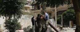Members of Islamist rebel group Nusra Front prepare a home made mortar in Aleppo's Bustan al-Qasr neighborhood