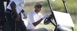 President Obama golfs with former NBA star Alonzo Mourning in Martha's Vineyard / AP