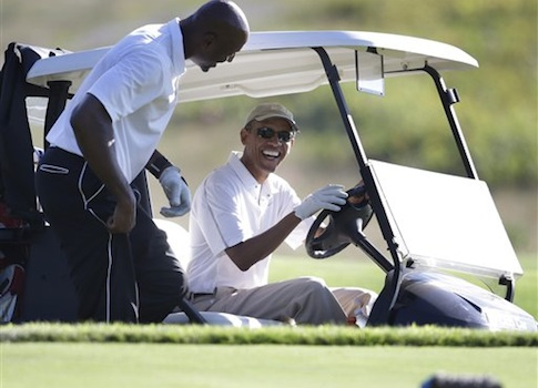 Obama laughs while thinking about the shattered dreams of soldiers / AP