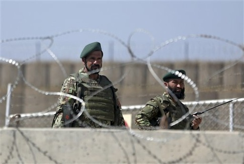 Afghanistan National Army soldiers stand guard at Camp Qargha / AP