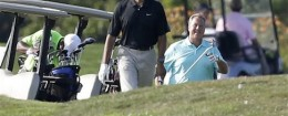 President Barack Obama and golf partner Robert Wolf / AP