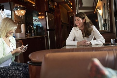 Alison Lundergan Grimes with her press secretary on the campaign bus / AP