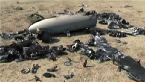 In this undated image taken from the Iranian state TV's Arabic-language channel Al-Alam, shows what the broadcast purports is an Israeli drone the country's Revolutionary Guard claimed to have shot down over the weekend near an Iranian nuclear site