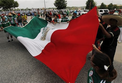 Mexico soccer fans wave their national flag in Arlington, Texas / AP