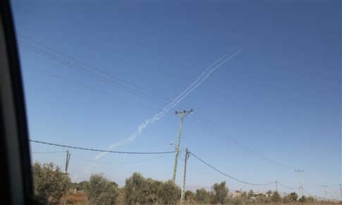 Smoke trails are seen as a rocket is launched from the east Gaza City towards Israel on August 19