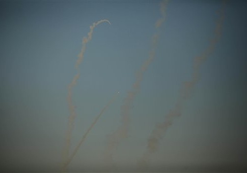 Smoke trails are seen as rockets are launched from the Gaza Strip towards Israel on August 20