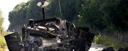 A burned Israeli humvee that was part of a convoy attacked by Hezbollah guerillas where two Israeli soldiers were captured, is seen on a road between Zarit and Shtula in northern Israel, on the border with Lebanon, Wednesday, July 12, 2006